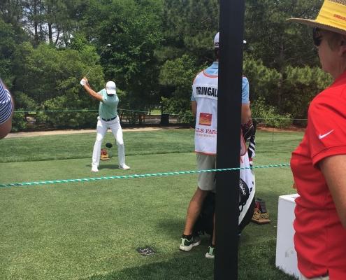 A golfer, mid-swing!