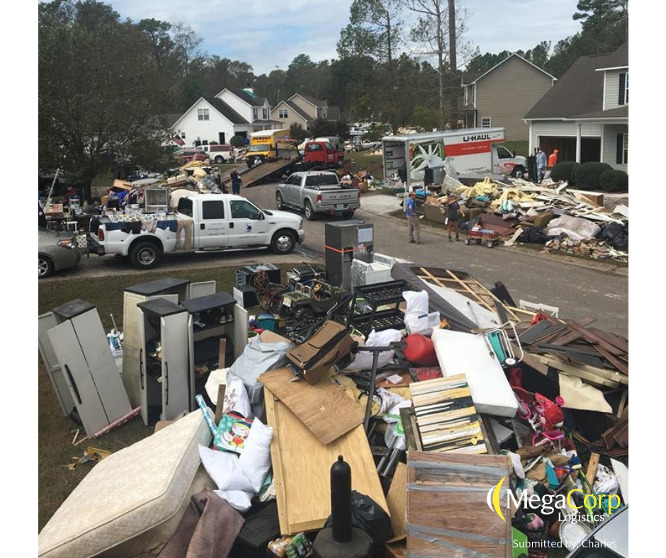 Broken cabinets, mattresses, box-spings and appliances scattered in the yards of Florence victims. There are several moving trucks parked on the street and in driveways, in preparation to move all of the items.