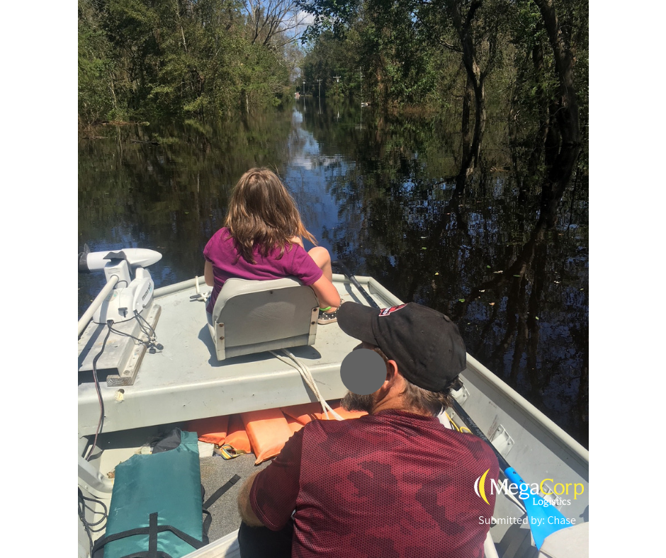 Travelling by boat in the aftermath of hurricane Florence.