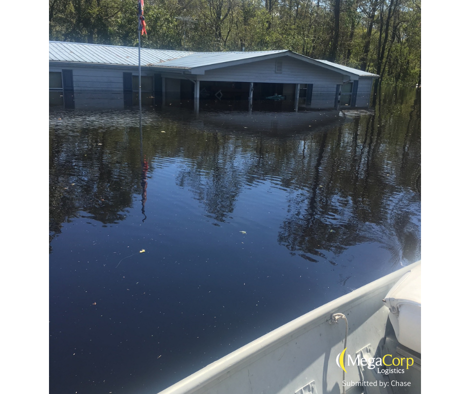 The outside of a house that is half underwater.