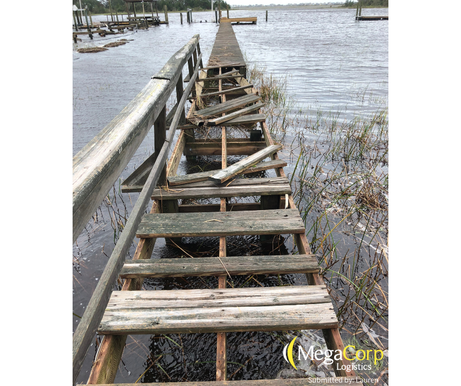 A pier that was destroyed by the hurricane - only a few boards remain nailed to the structure.