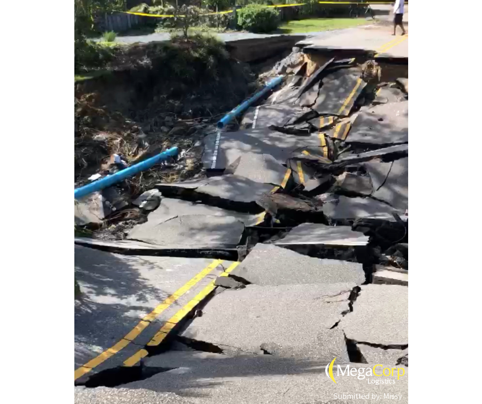 A road that has completely crumbled due to the storm.